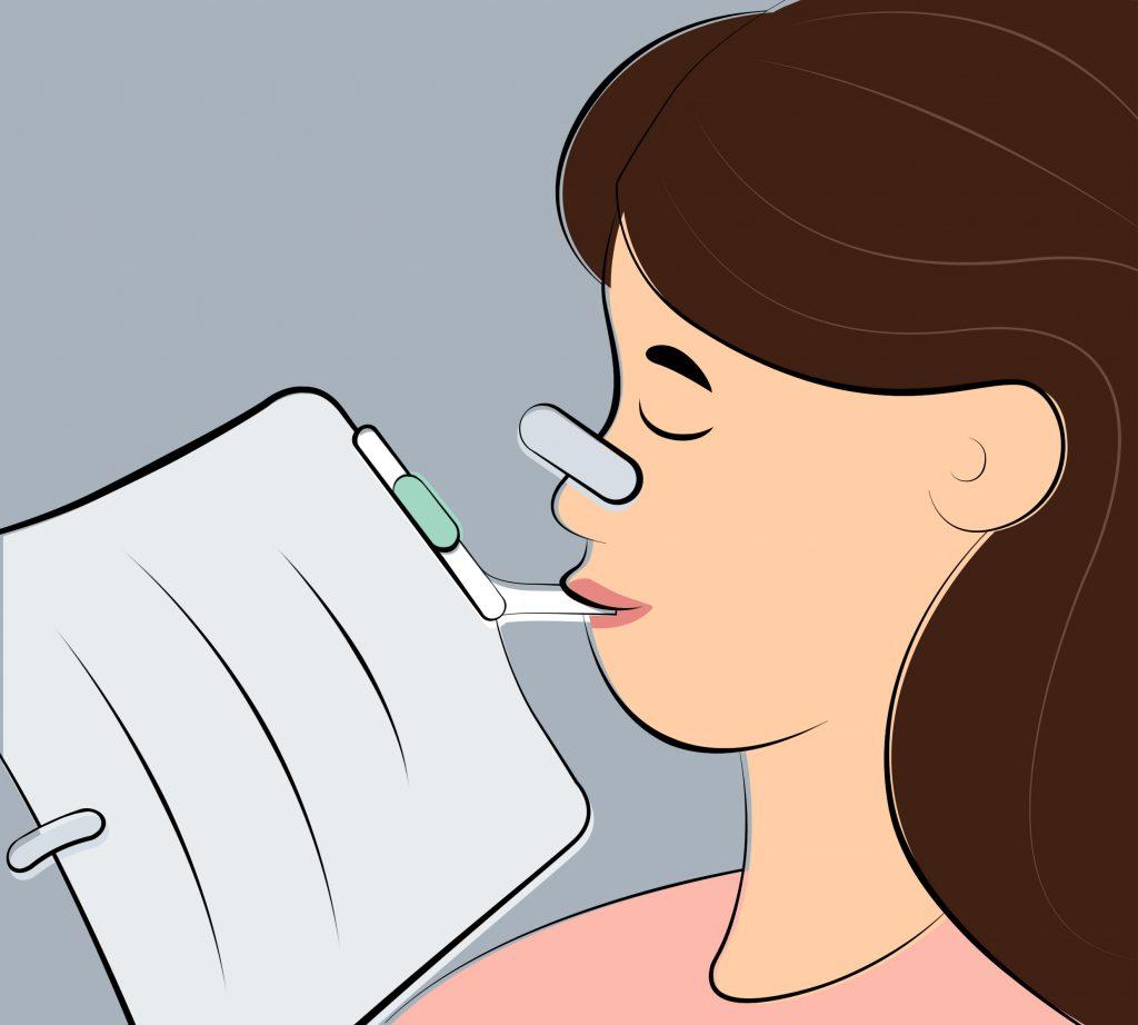 Woman breathing through Rehaler